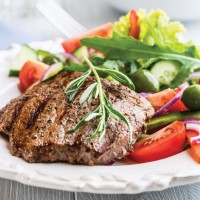zizzling steak and salad