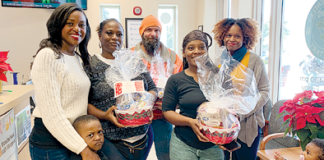 Ashlen Bond-Lilly distributes 100 holiday food baskets to Phillis Wheatley Elementary School